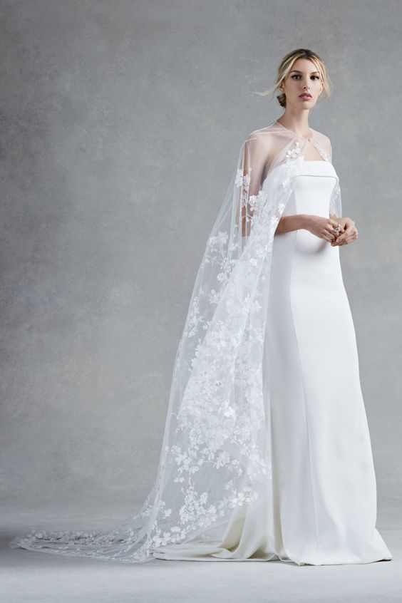 ethereal lace applique cape makes a minimalist wedding dress more feminine