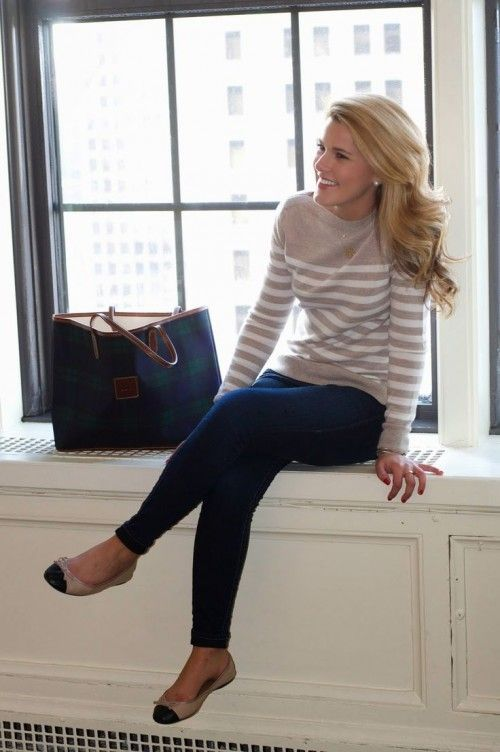 a neutral striped sweater, navy jeans and beife and black flats to feel comfy
