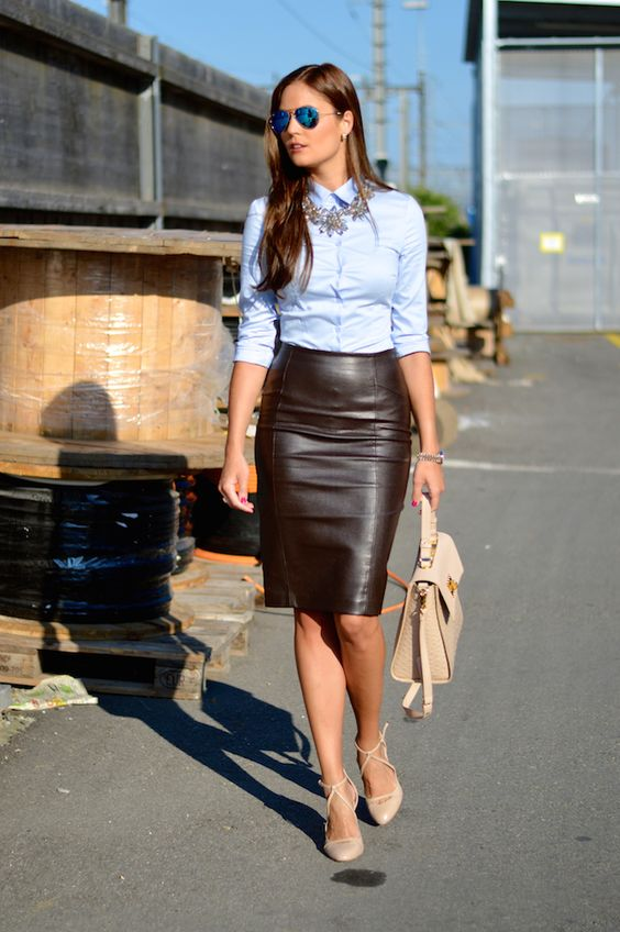 a black leather skirt, a blue shirt, a statement necklace, blush lace up heels and a bag