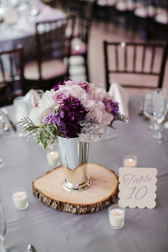 a chic floral arrangement with blush, white and purple blooms in a silver vase