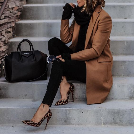 a black turtleneck sweater, black skinnies, leopard rpint shoes and a brown coat