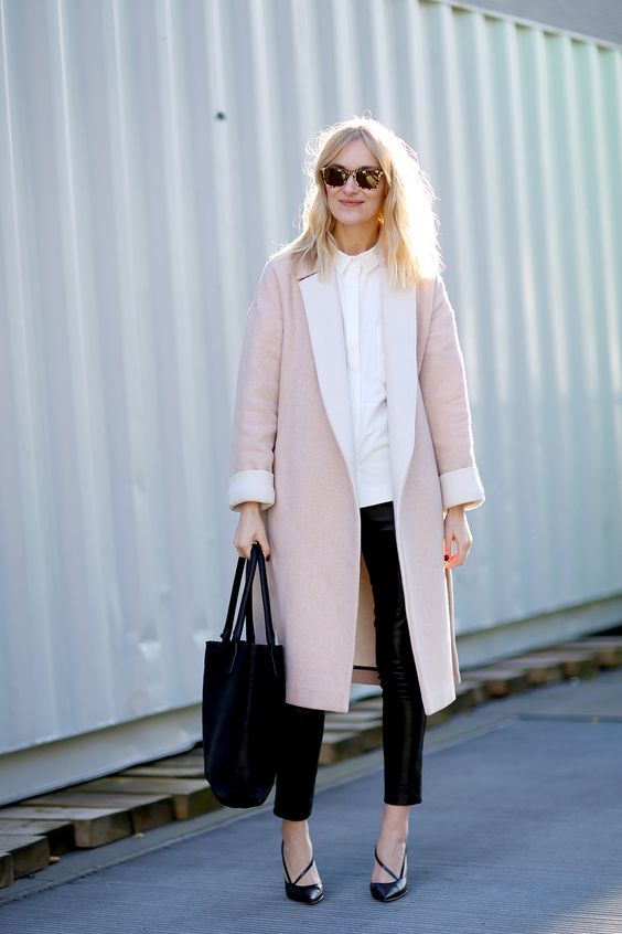 black cropped leather pants, a white shirt, black heels and a pink midi coat