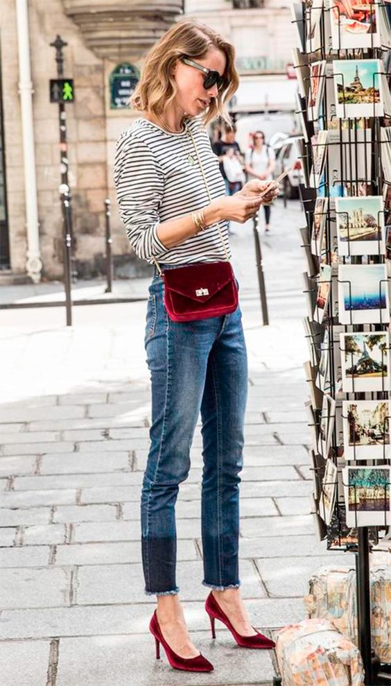 cropped jeans, a black and white striped shirt, burgundy velvet heels and a matching crossbody