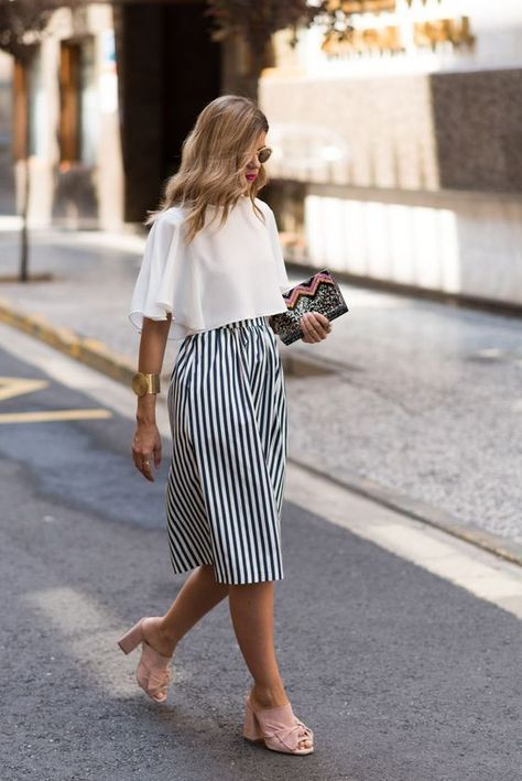 a striped midi skirt, a white crop top with ruffles, blush shoes