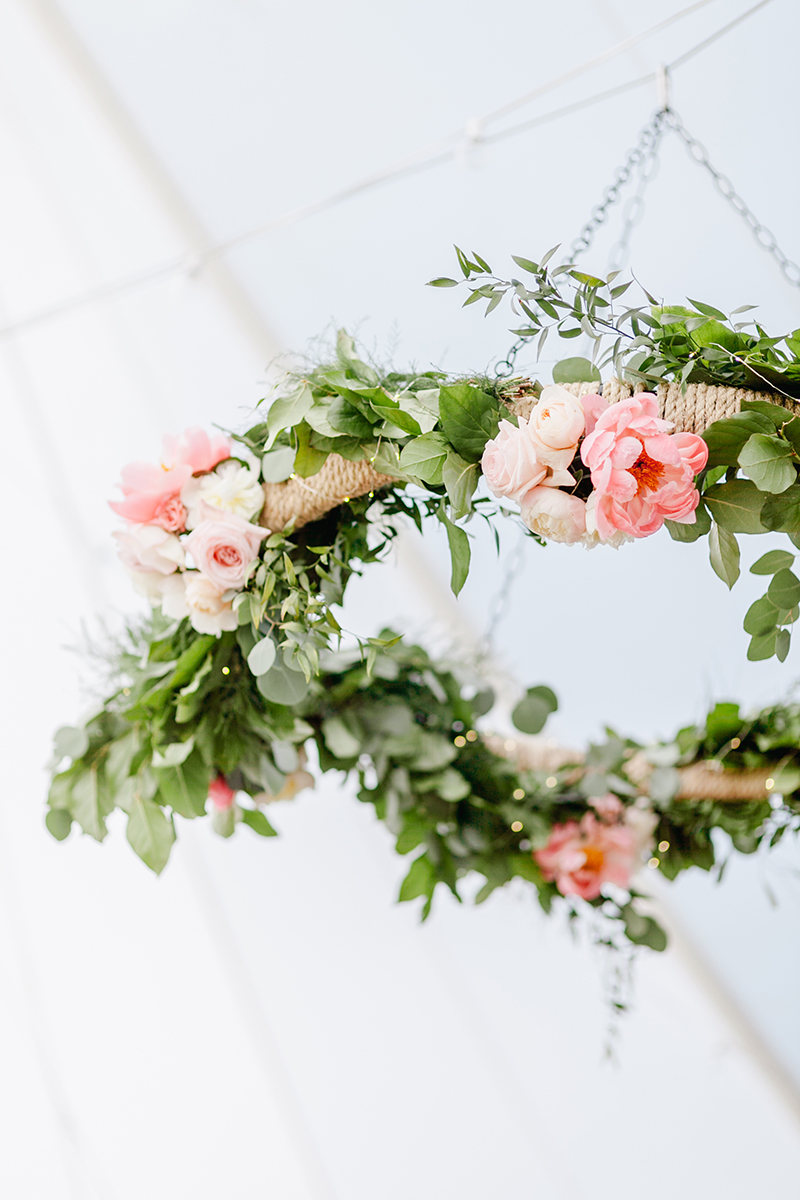 floral wreaths - photo by Emily Wren Photography http://ruffledblog.com/bright-beautiful-summer-wedding-with-geometric-accents