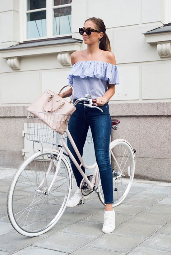 blue jeans, a blue off the shoulder shirt, white sneakers