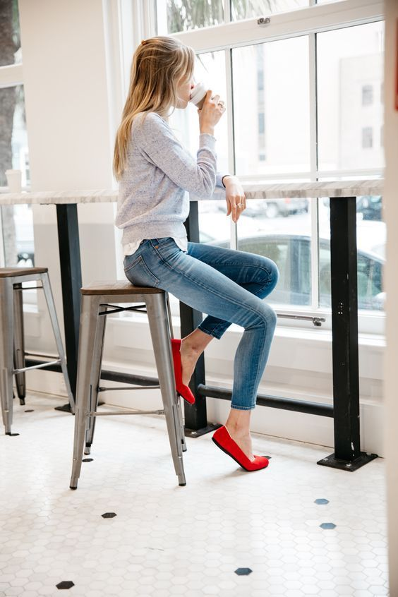 blue jeans, a grey sweatshirt and red flats for a casual look