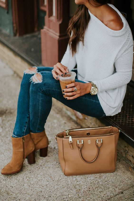 ripped blue skinnies, a white off the shoulder pullover and amber booties
