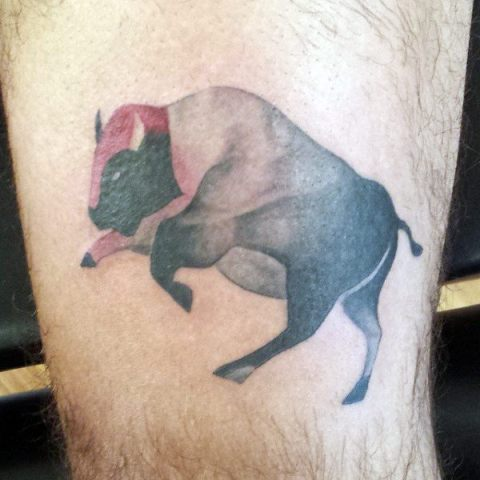 Black and red tattoo on the leg