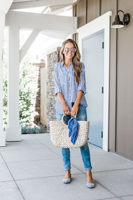 blue jeans, a striped blue and white shirt, striped flats and a wicker bag for a casual summer look