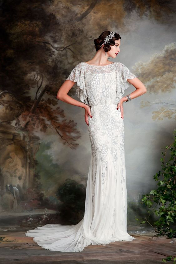 a bateau neckline wedding gown with flowy sleeves, embroidery and beading