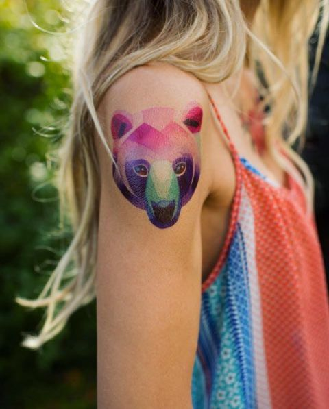 Adorable bear head tattoo on the shoulder