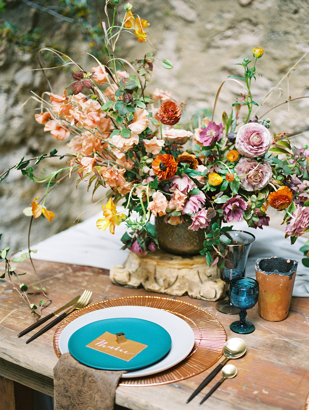romantic place settings with blue - photo by Charla Storey http://ruffledblog.com/architectural-san-antonio-mission-wedding-inspiration