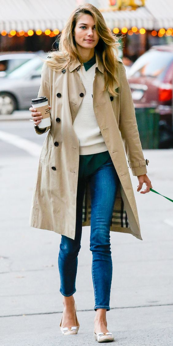 blue jeans, an emerald shirt, a white sweater, flats and a beige trench coat