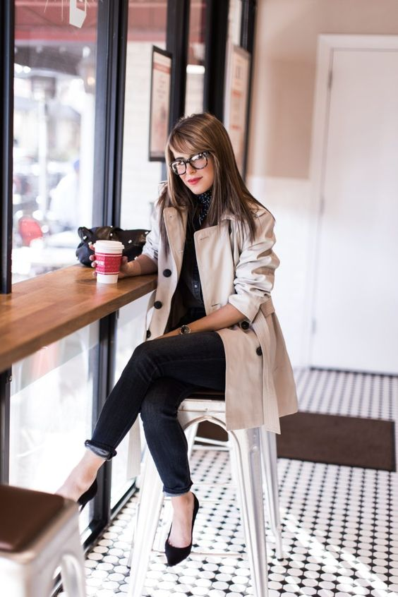 black jeans, black shoes, a creamy trench coat and black buttons for a work look