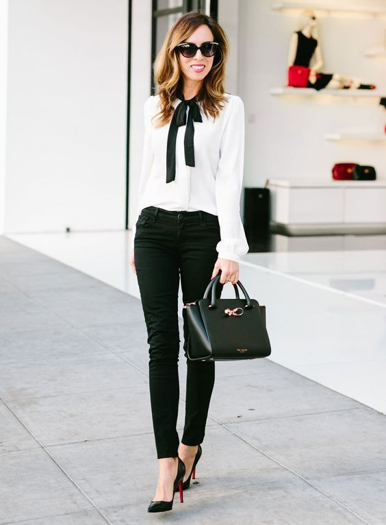 black skinnies, a white shirt with a black bow and black heels for work