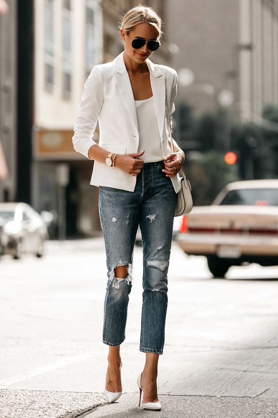 distressed cropped jeans, a white top, a white blazer and heels for late summer look