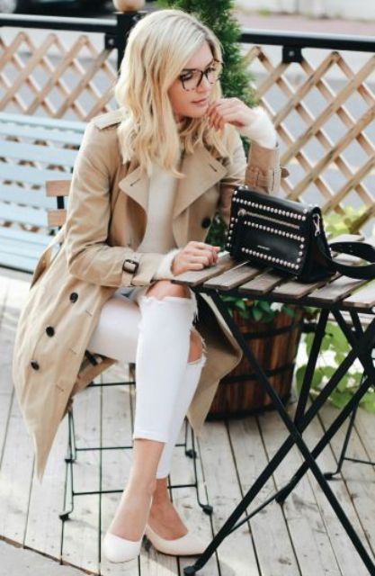 white ripped denim, white flats, a white sweater and a beige trench coat with black buttons
