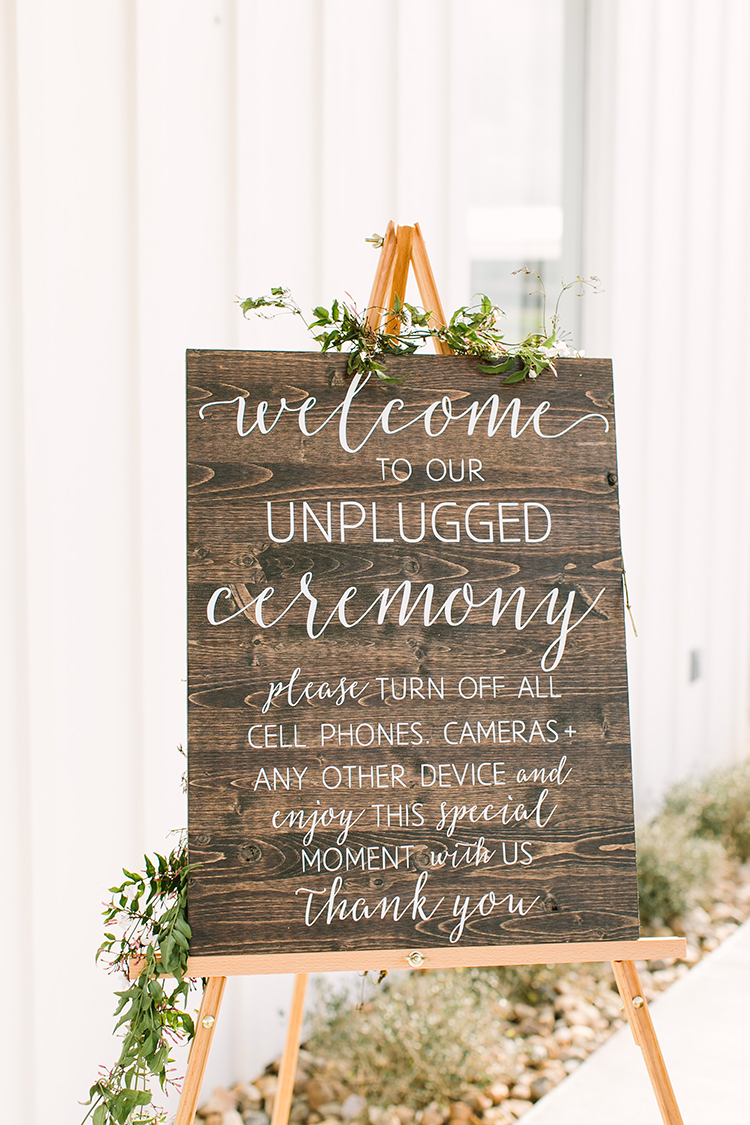 unplugged wedding ceremony signs - photo by Mustard Seed Photography http://ruffledblog.com/modern-farmhouse-wedding-with-organic-details