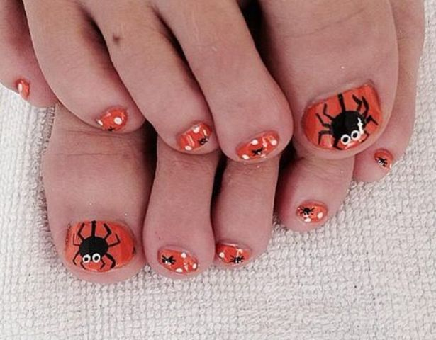orange toe nails with spiders and polka dots look cut yet Halloween-like