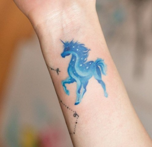 Blue unicorn tattoo on the wrist