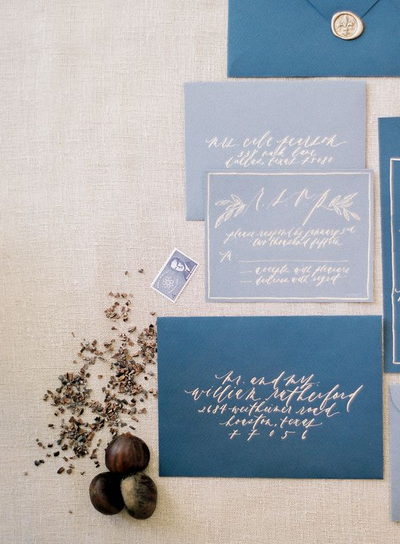 indigo envelopes and slate grey invites with silver calligraphy