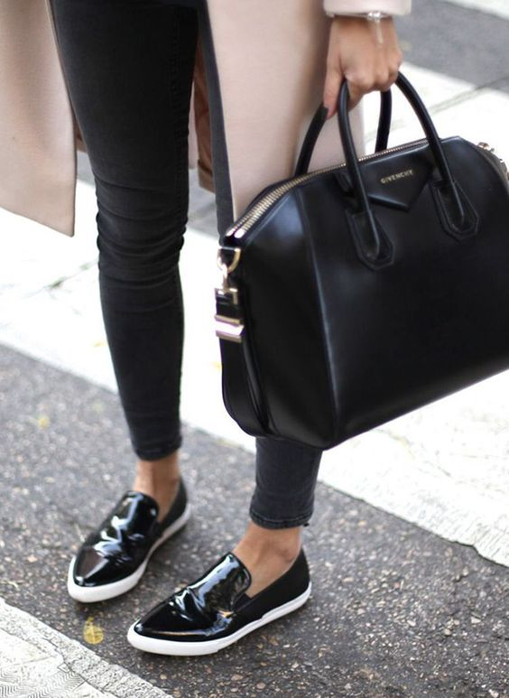 an average size black leather bag is classics that fits many occasions