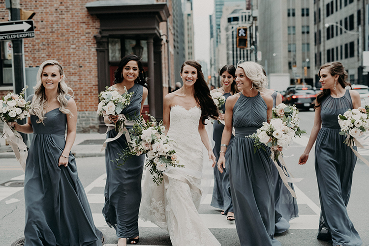dove grey bridesmaid dresses - photo by Scarlet ONeill http://ruffledblog.com/industrial-space-meets-enchanted-forest-wedding