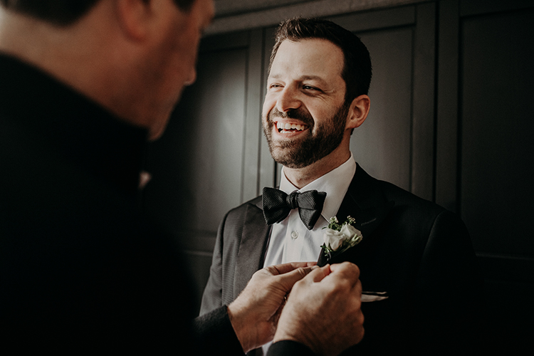 groom getting ready - photo by Scarlet ONeill http://ruffledblog.com/industrial-space-meets-enchanted-forest-wedding