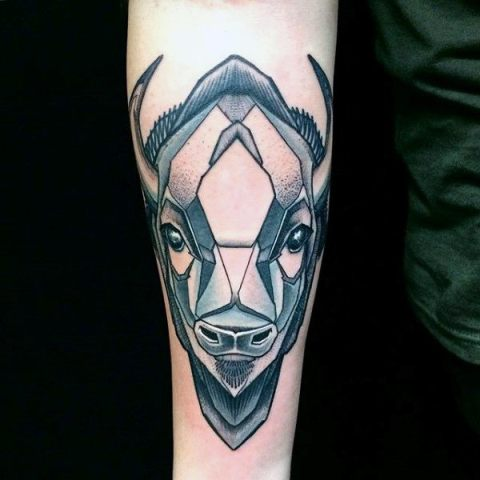 Abstract bison tattoo on the arm