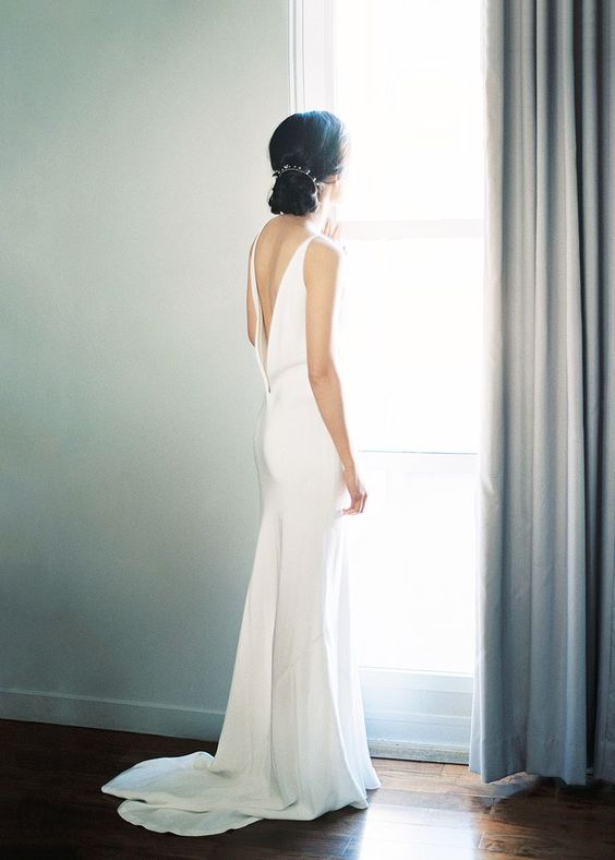 modern sheath wedding dress with a low back and a small train for a chic look
