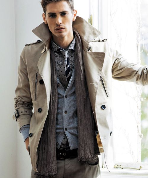 a neutral trench, pants, a vest, a polka dot shirt and a polka dot tie for a layered fall look