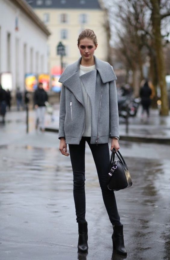 black jeans, a white sweater, a short grey coat and black boots