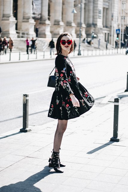 With floral dress, ankle boots and mini bag