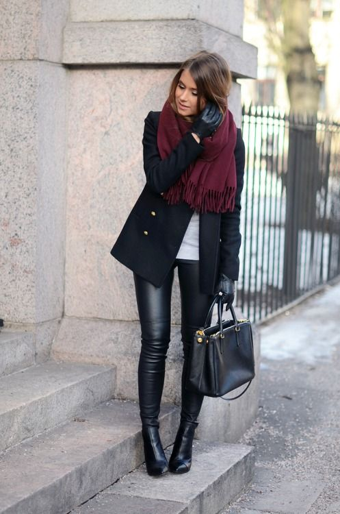 leather pants, black booties, a short black coat and a burgundy scarf