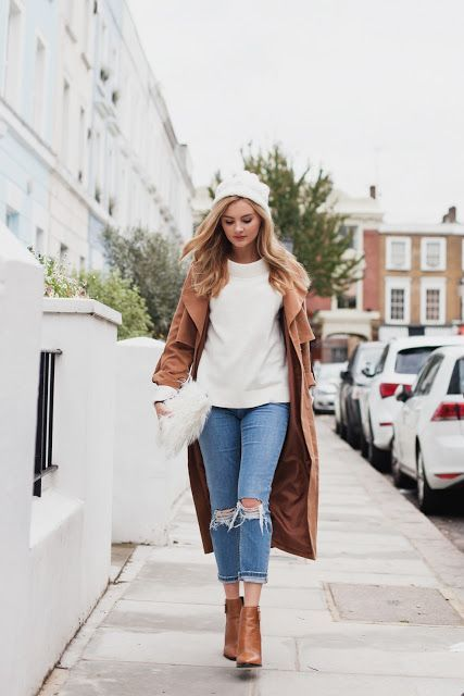 ripped cropped jeans, a white sweater, a camel coat, matching booties and a white beanie