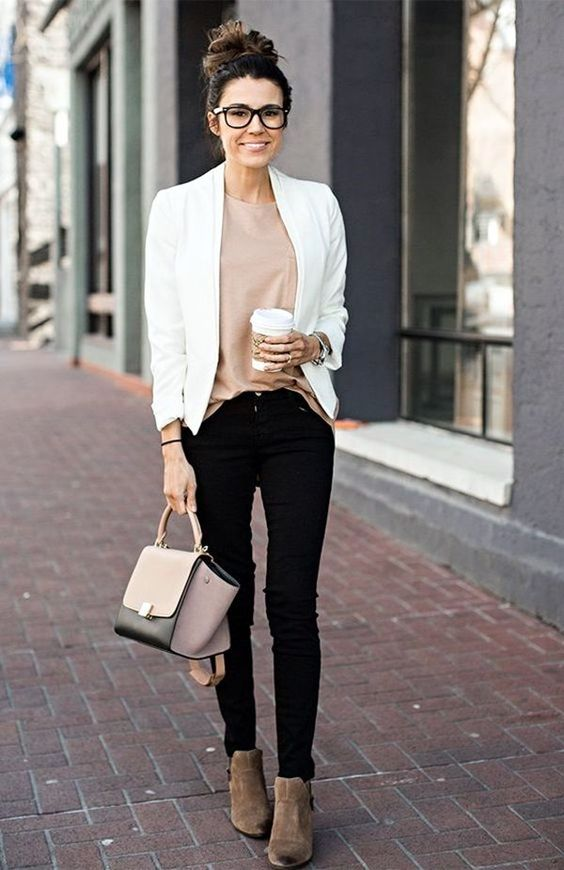 black jeans, a neutral top, brown suede booties, a white blazer and a blush and black bag