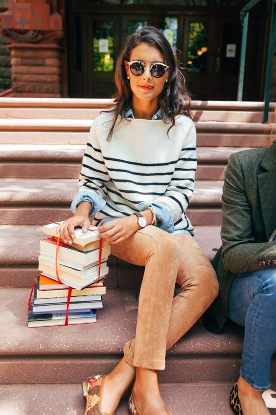 a chambray shirt, a striped sweater, orange velvet pants and flats