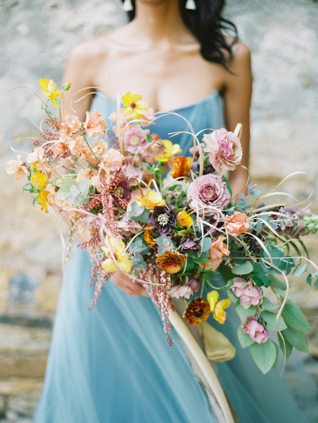 yellow and pink wedding bouquets - photo by Charla Storey http://ruffledblog.com/architectural-san-antonio-mission-wedding-inspiration