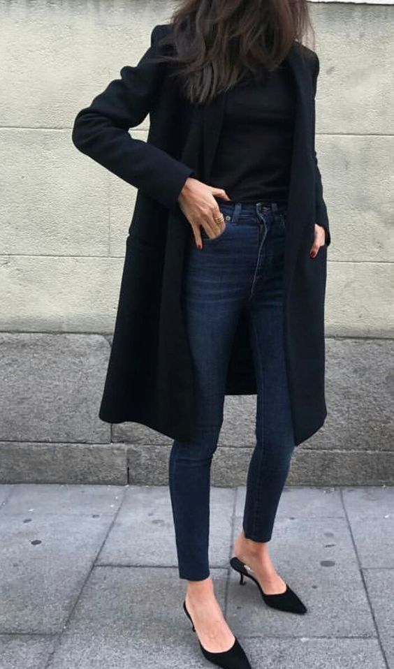 navy skinnies, a black turtleneck, a black coat and heels for a fall look