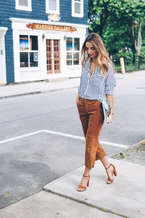 a striped black and white shirt, ocher velvet cropped pants and matching heels