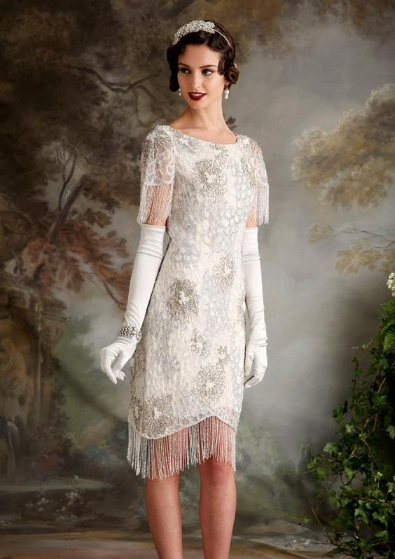 a short wedding dress with short fringed sleeves, with a fringed skirt and beading