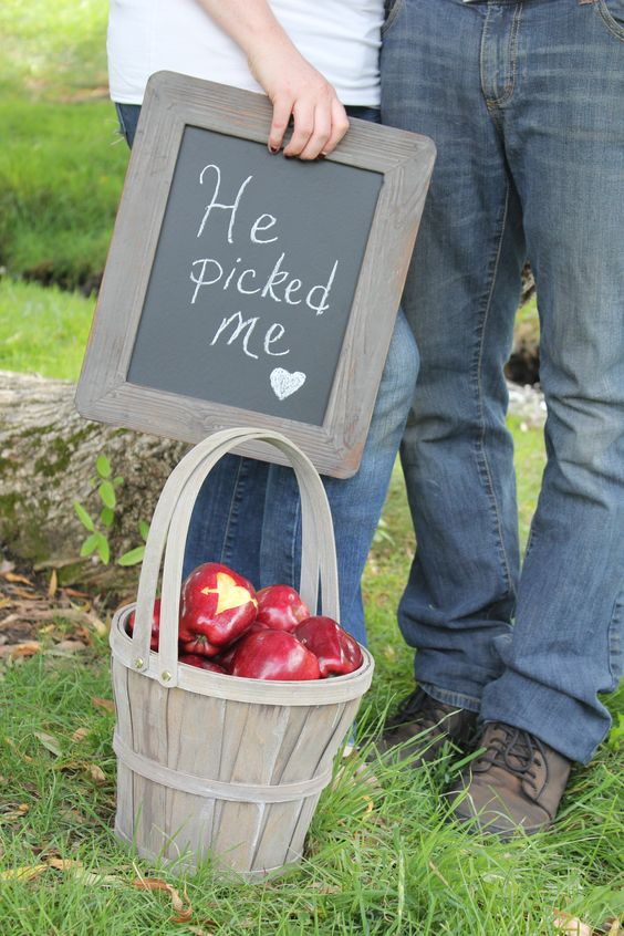 apples are truly fall-like, and you can incorporate them into your engagement shoot
