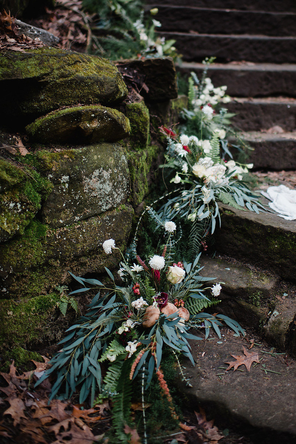 The staircase was decorated with greenery and blooms coming down like a garland