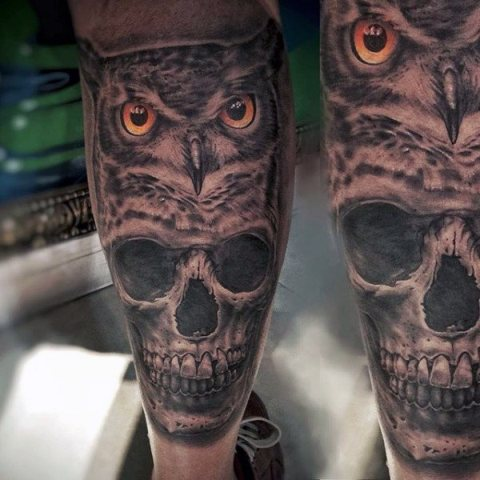 Owl and scull tattoos on the legs