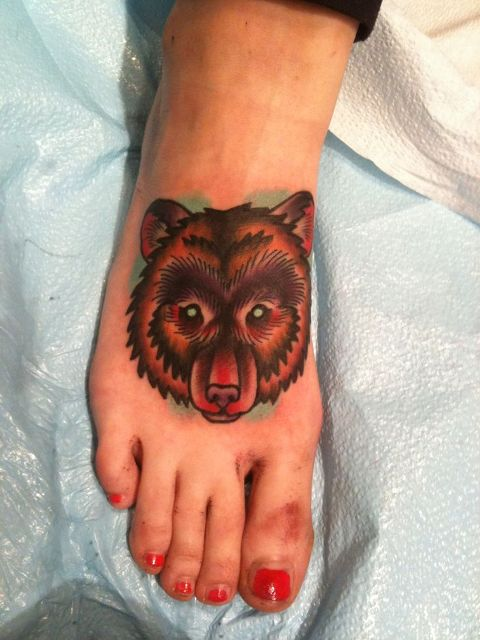 Bear tattoo on the foot
