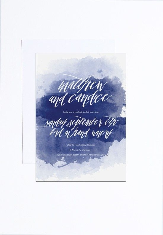 a bold watercolor indigo wedding invite with white letters