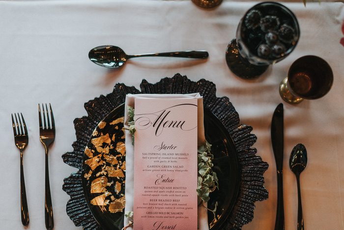 The tablescape was complemented with textural black chargers and gold leaf black plates
