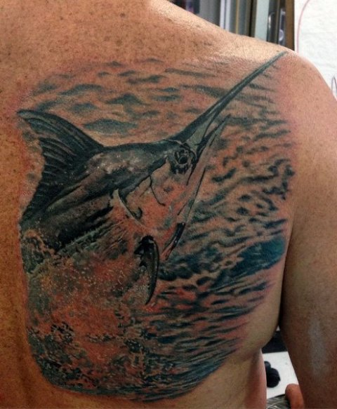 Big fish tattoo on the back