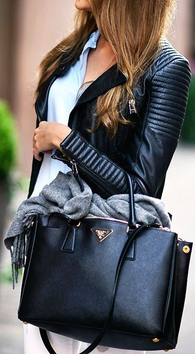 a textural black bag with a long strap is ideal to go to work